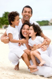 Happy step-family vacationing on the beach.